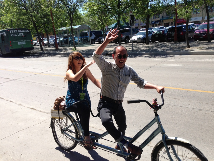 991 Fresh Radio's Vicki Shae and Downtown Biz' Jason Syvixay riding in style (Tourism Winnipeg)